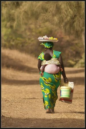 Gambian woman and baby